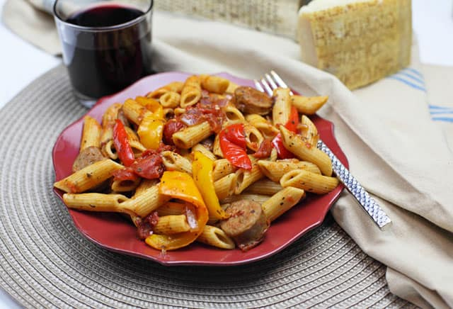 Sausage, peppers & onions pasta - a twist on the Italian classic thats affordable to make and you can even use leftovers. Cook once, eat twice!