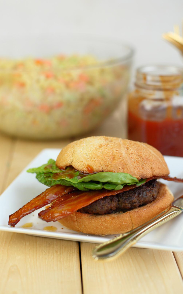 A lean Canadian beef burger topped with maple-candied bacon and homemade maple BBQ sauce, this burger is an ode to all things Canadian. The perfect burger to enjoy for Canada's Day long weekend.