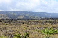 The view from near the ocean, back up to where the higher part of Chain of Craters Road is.