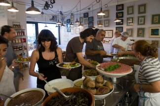 Guests help themselves to the buffet at Tawlet on November 11, 2010 in Beirut, Lebanon. Photo by Jamie McDonald