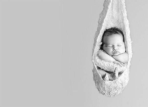 newborn sleeping baby black and white