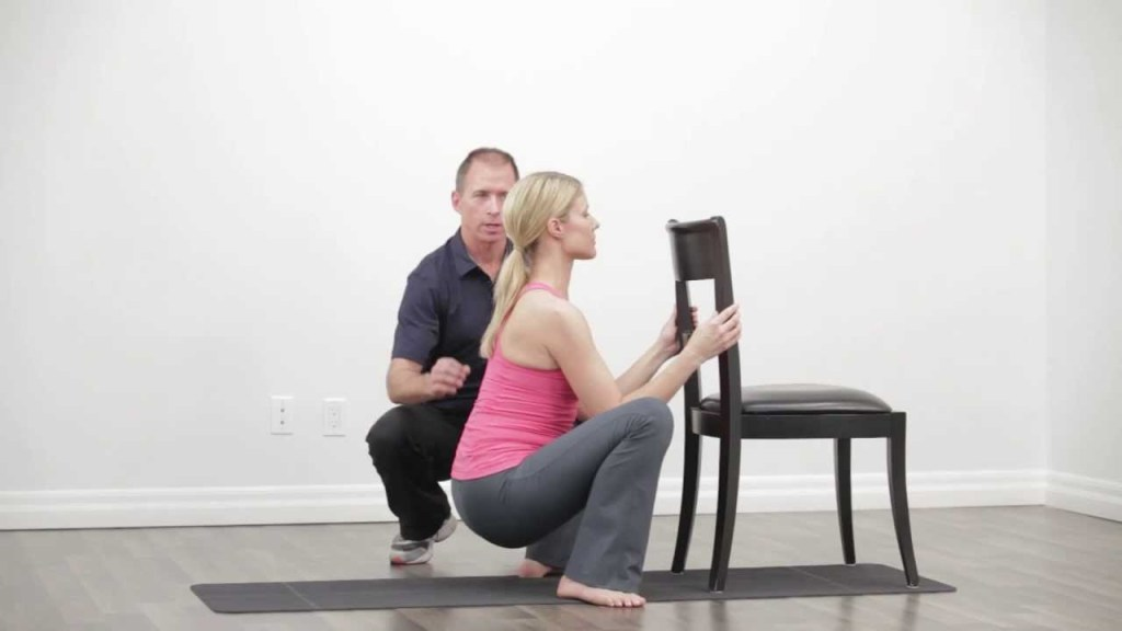 Squat stretch with chairs