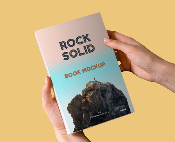 Paperback Book In Hand Mockup PSD