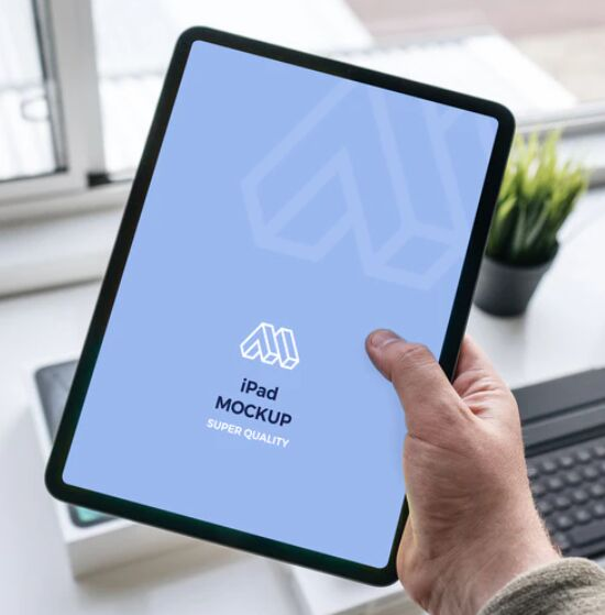 Tablet (iPad) In Hand Mockup