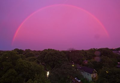 This is an amazing shot.. a 'red rainbow' appeared over Atlanta last week after a storm.. Beautiful. It looks eerily like the cover of UNDER THE DOME by Stephen King..