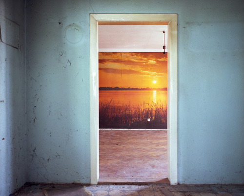 plizm:</p> <p>untitled by Lostmuzak on Flickr.</p> <p>Is reality on the inside or the outside?<br /> Are we in a drab room,<br /> looking out at the sunset?<br /> Or we standing outside by the water<br /> with a fake room around us?<br /> If we try to leave the room,<br /> will a door shut us in or will<br /> we be able to walk outside?<br /> Where do we want to be?<br /> The room offers shelter and comfort,<br /> while the outside offers adventure and freedom.<br /> Once we know the answer to this question, then<br /> we will know if the walls will lift away for us.</p> <p>
