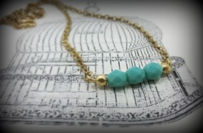 gold necklace with turquoise glass