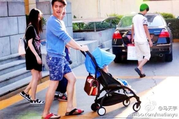 Ma Tianyu pushing around a baby stroller