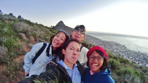 Fooling around while watching the sunset together at Signal Hill Capetown