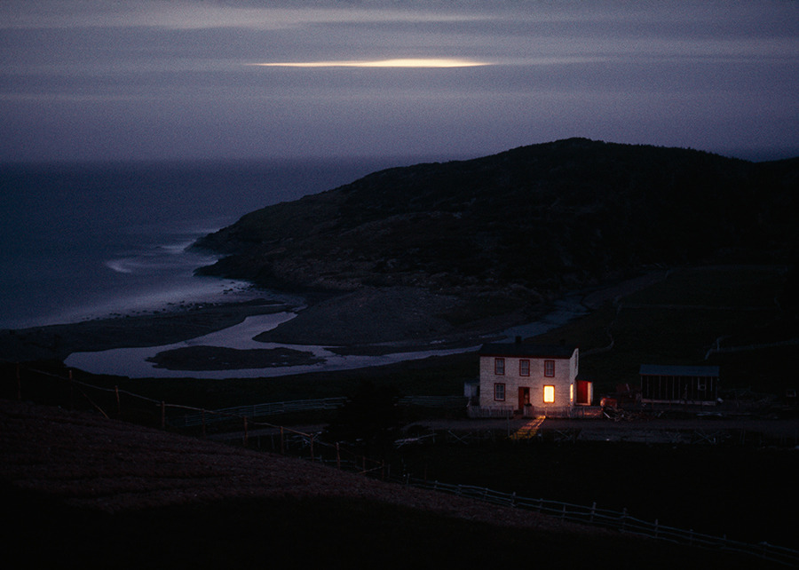 A solitary fisherman's home keeps watch on quiet Placentia Bay in Newfoundland, Canada, 1974.Photograph by Sam Abell, National Geographic Creative