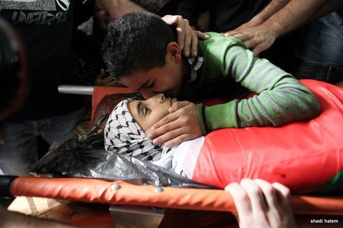 nowinexile:</p><br /><br /><br /><br /><br /><br /> <p>Bahaa Bader's twin brother kisses him before burial.<br /><br /><br /><br /><br /><br /><br /> The 13 year old Palestinian boy was shot 3 times in the chest by an Israeli soldier last night in Beit Laqiya and died from severe bleeding.<br /><br /><br /><br /><br /><br /><br />