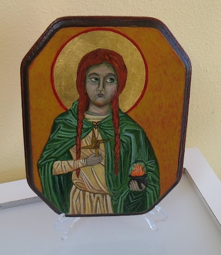 asksecularwitch:  spiritscraft:  Brigit Icon by Sara Star  That is so good that I first thought it was an Orthodox Icon. The style is right on with the paintings of them. Very awesome.  Thank you asksecularwitch! I learned to paint under an Greek Orthodox ikonographer (although she is Episcopalain).  I noticed a lot of Hindu icons done in the same basic style. I also read that the icon style was heavily influenced by Egyptian art. So I took an interest in transferring that style to additional polytheist subjects, I made this one of Brighid/Brigit which especially highlights the interplay between saint/goddess role she plays for the Irish and Irish Americans like me. I am also completing a triptych/quatrych of the Morrigan, using similar methods, but I am not using the traditional halo. A number of saints play an important role for witches, ie Saint Sara and The Black Madonna. So I also have been painting some of these. I love that a skill I picked up while testing out the Christian church can translate into something special and sacred in my polytheist life if done carefully.