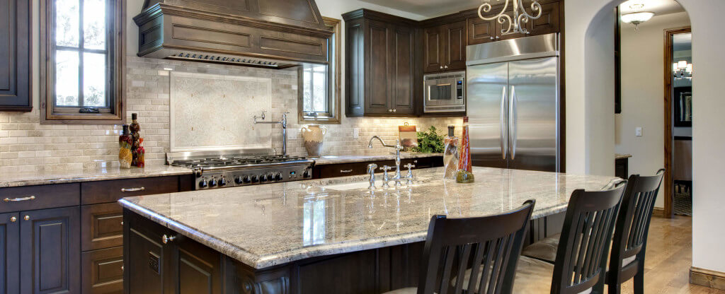 granite kitchens kyocera kitchen michigan countertops great lakes marble countertop brown cabinets