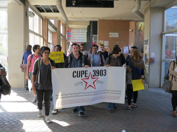 CUPE 3903 members march through the Student Centre on their way to the September 26 bargaining meeting with the Employer. (photo credit: Bob Hanke)