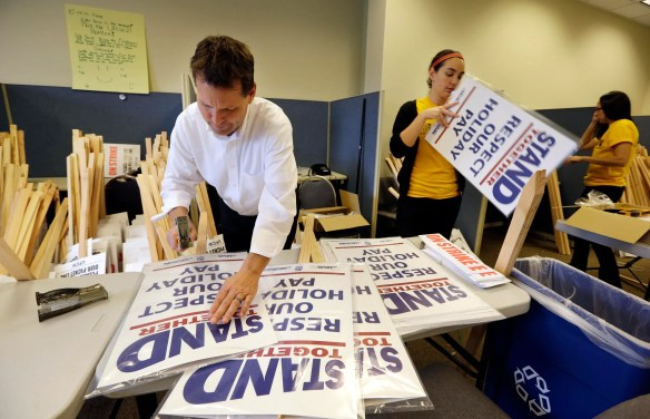 Members of the United Food and Commercial Workers assemble placards at their union local headquarters in advance of a strike.
