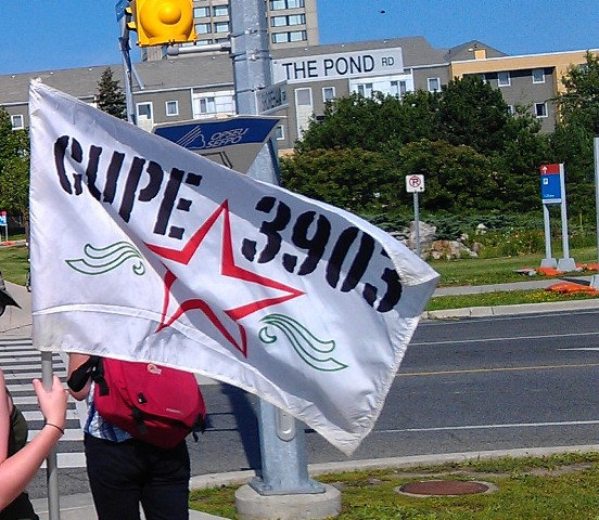 A CUPE 3903 flag flies in the wind.