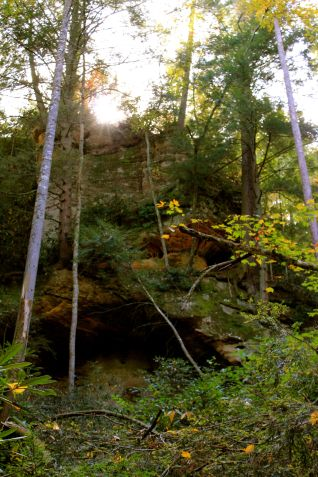 rock shelf with sun beams
