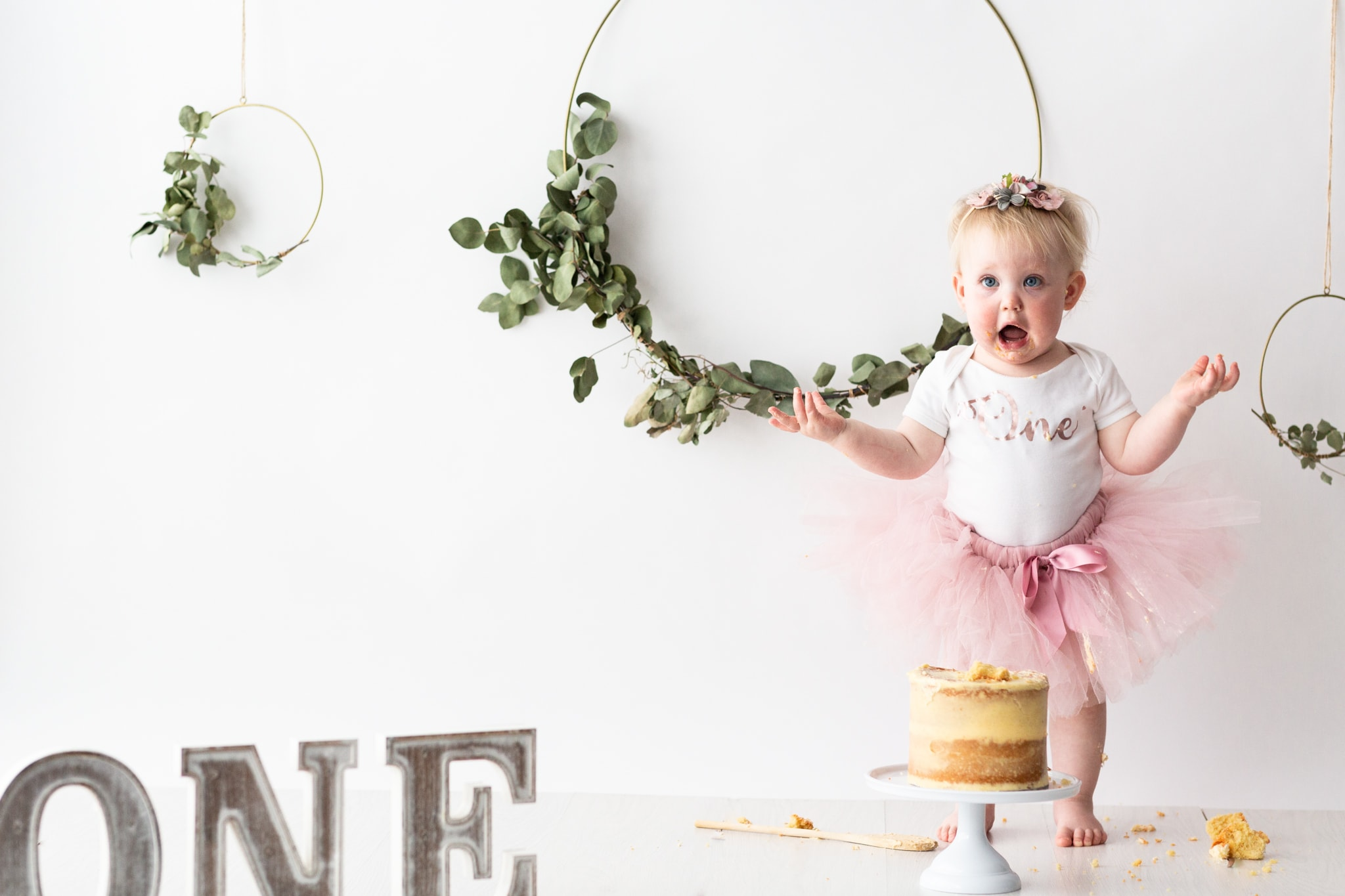 first birthday Kent cake smash photoshoot in Bexley little girl in tutu