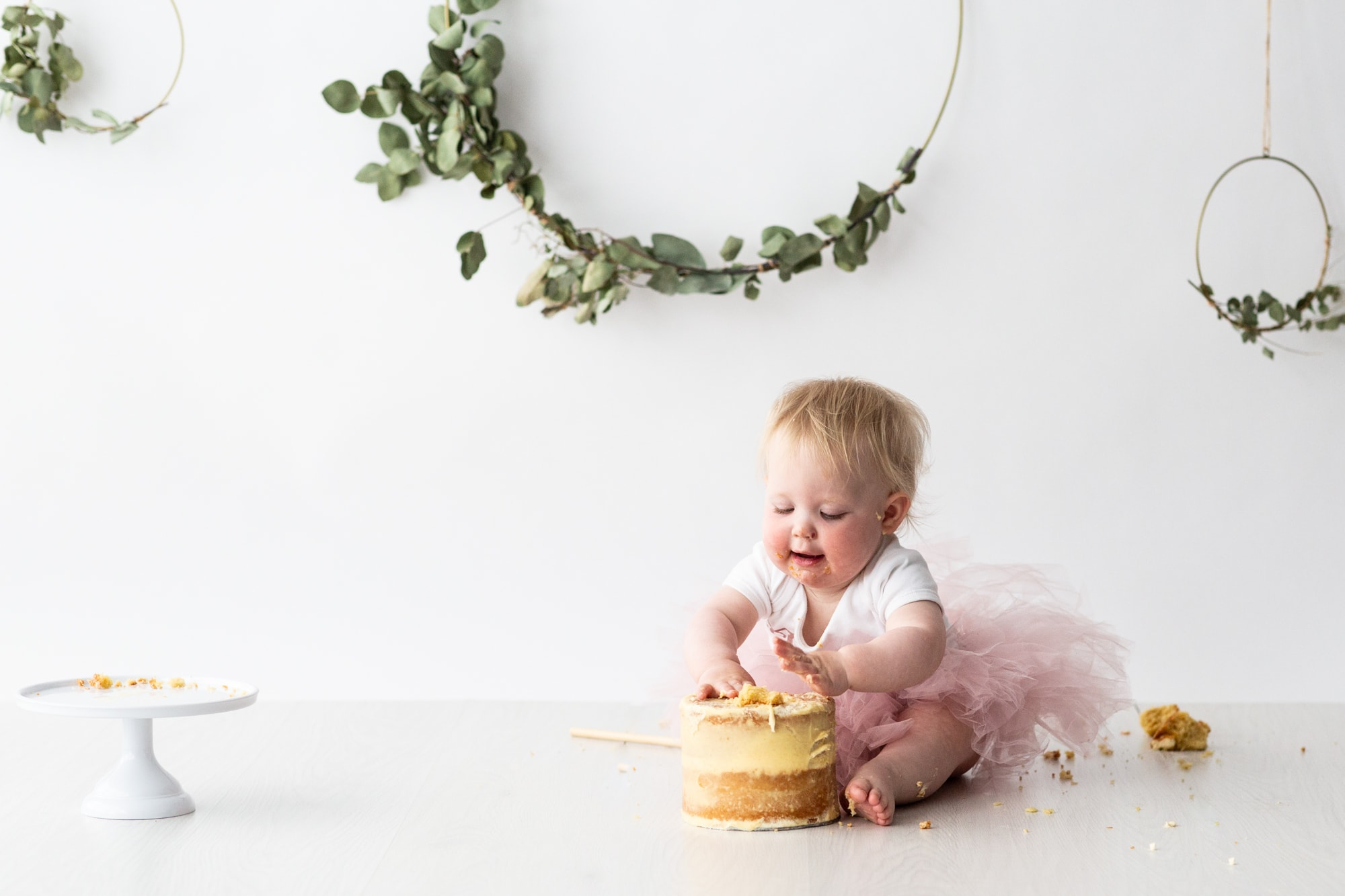 little girl wearing a tutu at her Kent cake smash photoshoot in Bexley