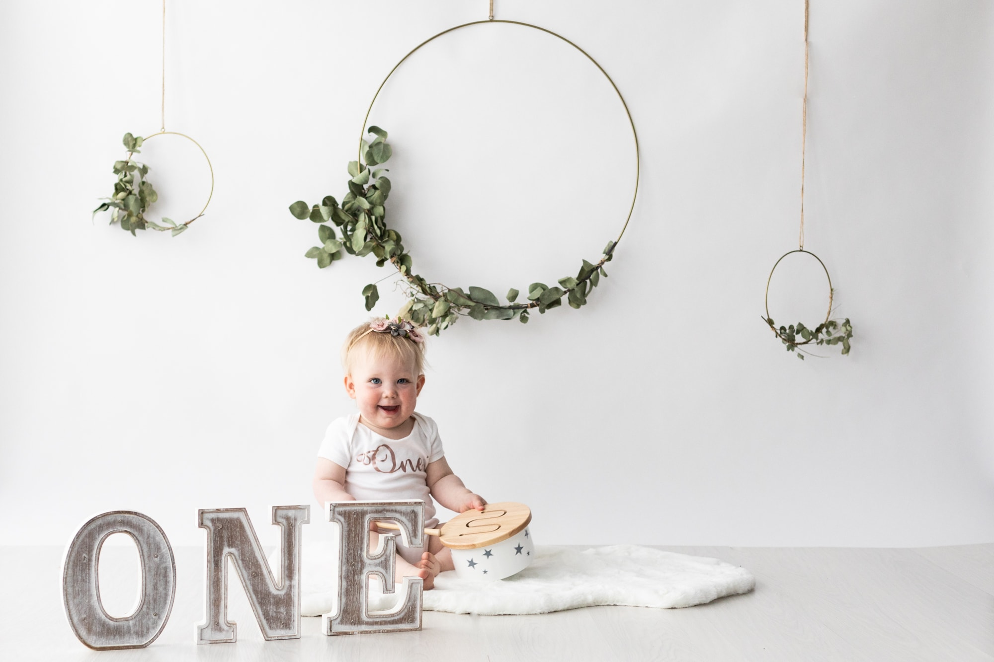 baby girl white studio set up at her Kent cake smash photoshoot