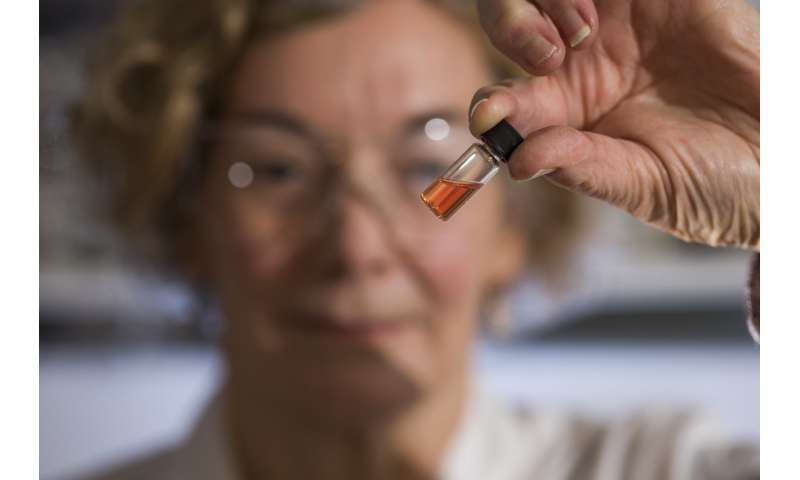 Biogeochemistry Lab Manager Janet Hope From The Anu Research School Of Earth Sciences Holds A Vial Of Pink Colored Porphyrins Representing The Oldest Intact