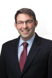 photo of male attorney wearing suit and tie