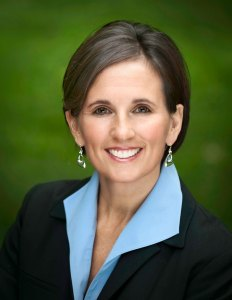 photograph of female executive in a blue shirt