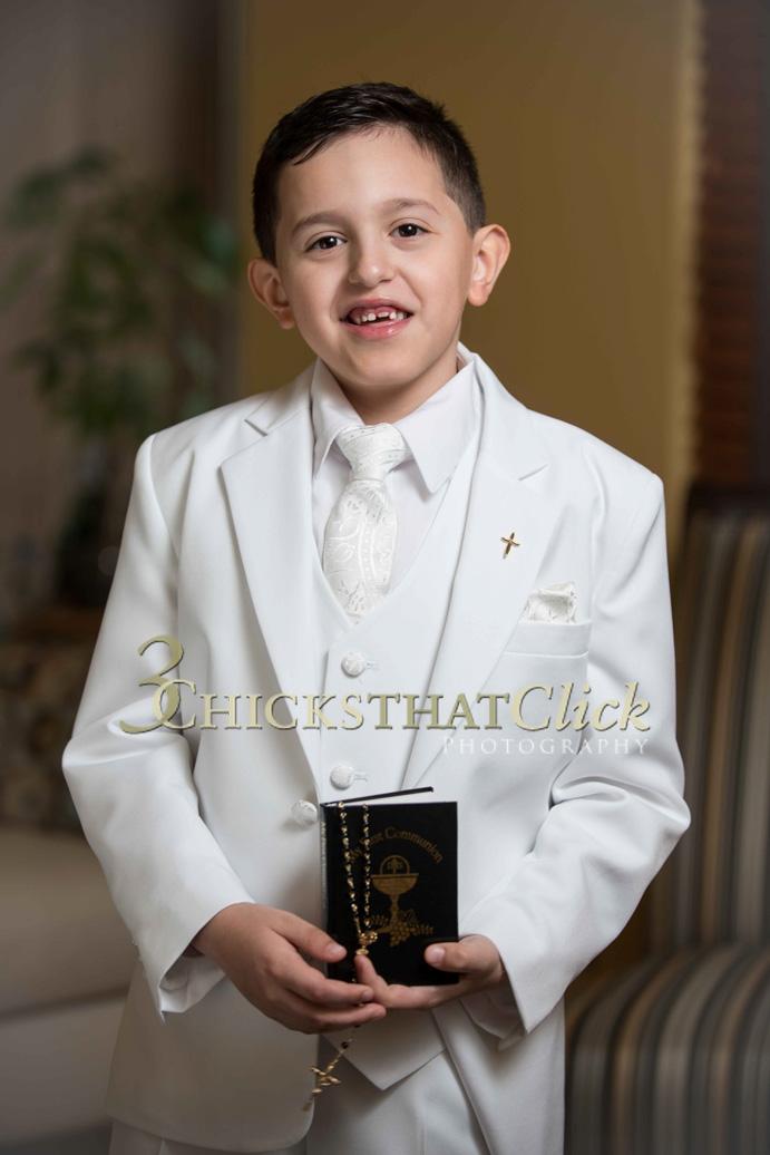 Boy in white 1st Communion suit