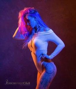 Elizabeth Rose, tattoo model with gels. Unicorn hair, multi color hair