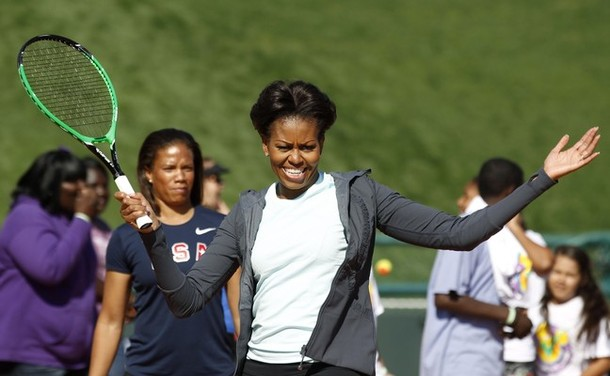 """U.S. First Lady Michelle Obama plays mini-tennis during a """"Let's Move!"""" faith and communities physical activity in Orlando"""