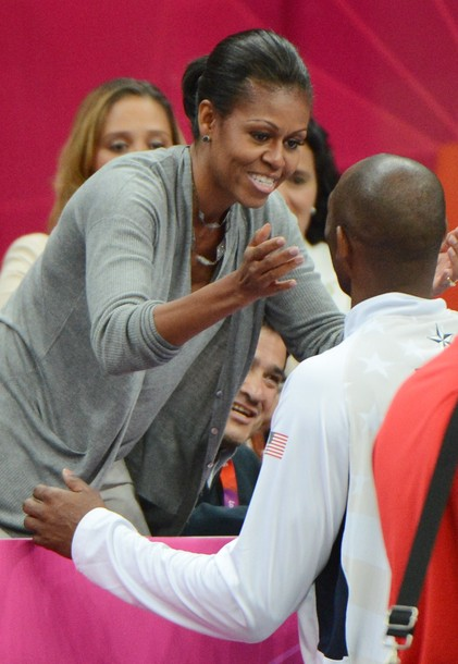 A US basketball player is congratulated