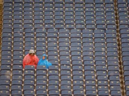 football-empty-stadium-seats-rain