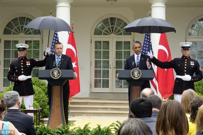 Marines hold umbrellas over U.S. President Barack Obama13