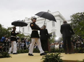 Marines hold umbrellas over U.S. President Barack Obama14