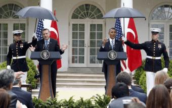 Marines hold umbrellas over U.S. President Barack Obama15