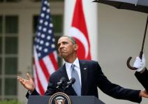 Marines hold umbrellas over U.S. President Barack Obama2