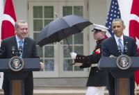 Marines hold umbrellas over U.S. President Barack Obama20