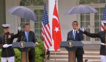 Marines hold umbrellas over U.S. President Barack Obama23