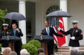 Marines hold umbrellas over U.S. President Barack Obama25