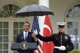 Marines hold umbrellas over U.S. President Barack Obama26