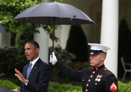 Marines hold umbrellas over U.S. President Barack Obama3
