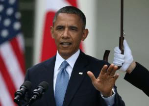 Marines hold umbrellas over U.S. President Barack Obama4