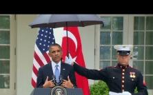 Marines hold umbrellas over U.S. President Barack Obama8