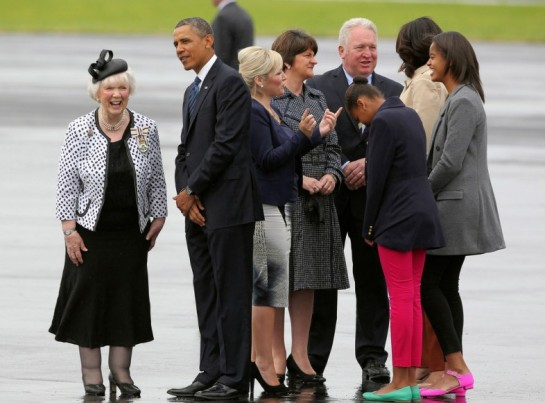 President Obama, the First Lady and their daughters Sasha and Malia are greeted by Joan Christie, the Queen's official representative in Northern Ireland, upon their arrival at Belfast International Airport