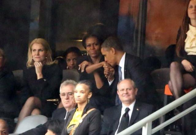 Barack Obama kissing Michelle Hand