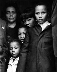 Dr King- Martin Luther King, Jr.'s widow, Coretta Scott King, and their children disembark the plane carrying King's body to Atlanta for his funeral.