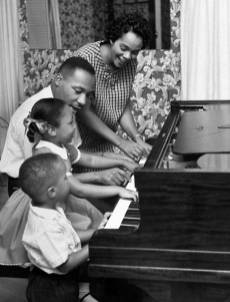 Dr King with his family at the piano.