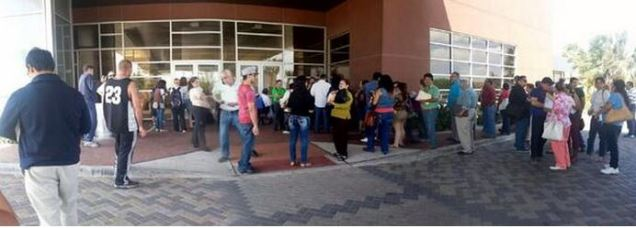 ACA Surge15-People lined up outside a library in McAllen, Texas on Sunday to apply for coverage under the Obama health law, a day before the end of open enrollment.