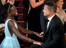 Lupita and Brad embrace as the happy news is announced on stage
