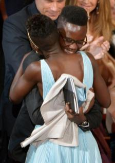 Lupita brother -Peter Nyong'o embraces sister Lupita Nyong'o after she wins the award for best actress in a supporting role